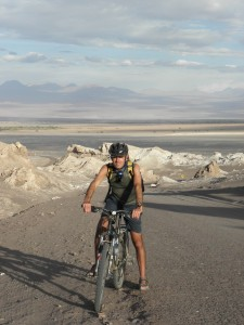 Marco biking in the Valle de Luna, Chile. Copyright ThinkingNomads.com
