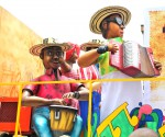 Big and colorful parade floats featuring a Vallenato band, music from around Cartagena. Copyright CareerBreakSecrets.com
