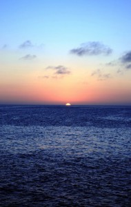 Sunset off the coast of Española Island, Galapagos. Copyright CareerBreakSecrets.com