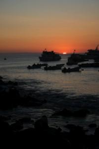 Sunset off San Cristobal Island. Copyright CareerBreakSecrets.com