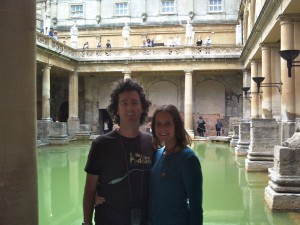 Craig and Linda at the Roman Baths in Bath, England. Copyright IndieTravelPodcast.com