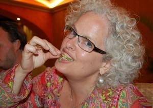 Janice eating a cricket. Copyright SoloTraveler.com