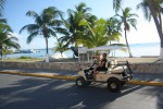 Jess driving a golf cart on Isla Mujeres, Mexico. Copyright GlobetrotterGirls.com